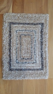 Hand knotted alpaca fibre mat 70cm x 48cm $215 NZD
