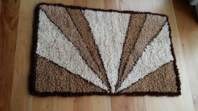 Hand knotted alpaca fibre mat. 110cm x 70cm $525 NZD plus postage by weight