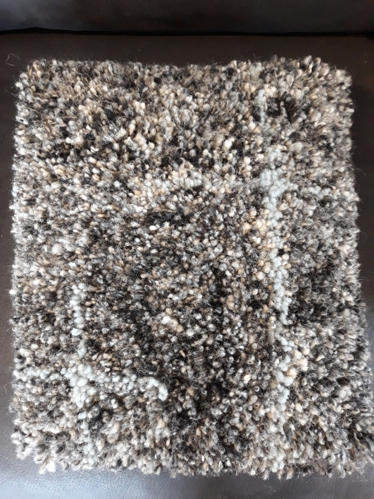 handknotted alpaca cushion with blue accent $66 NZD